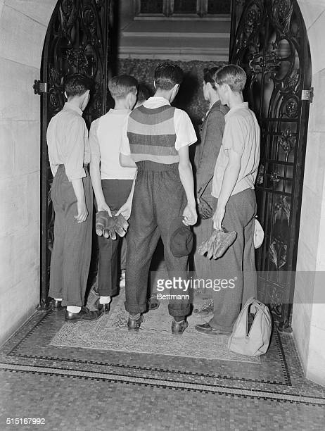 Baseball mitts and caps in hand a group of boys form Commerce High School view the body of Lou Gehrig at the E Willis Scott Funeral Parlor on 76th...