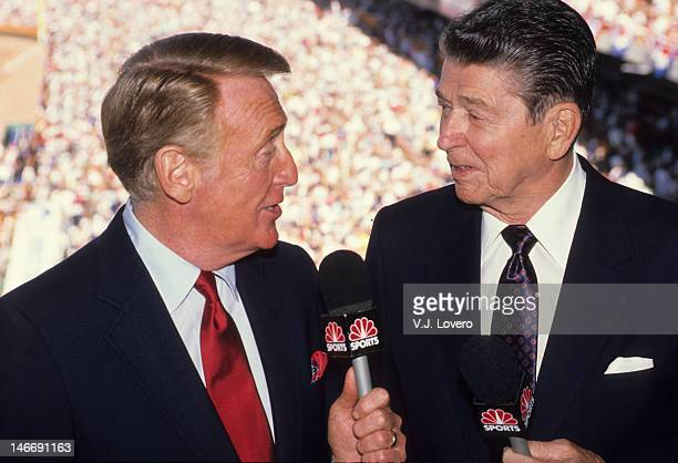 MLB All Star Game Former United States President Ronald Reagan and NBC Sports announcer Vin Scully in broadcast booth before game at Anaheim...