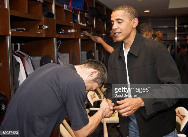 MLB All Star Game United States President Barack Obama gets a bow from Seattle Mariners Ichiro Suzuki in American League clubhouse before game during...
