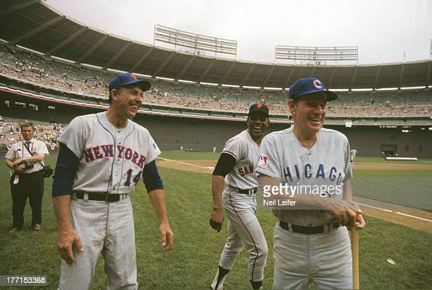 MLB AllStar Game New York Mets manager Gil Hodges San Francisco Giants Willie Mays and Chicago Cubs manager Leo Durocher on field before game vs...