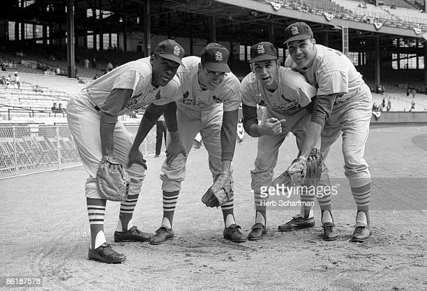 MLB AllStar Game Portrait of St Louis Cardinals Bill White Julian Javier Dick Groat and Ken Boyer before game vs American League at Cleveland Stadium...