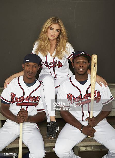 MLB Playoffs Preview Portrait of swimsuit model Kate Upton posing with Atlanta Braves Justin Upton and BJ Upton during photo shoot at Citi Field...