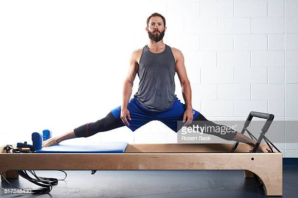 MLB Season Preview Portrait of Chicago Cubs pitcher Jake Arrieta demonstrating Pilates workout on Reformer equipment during spring training photo...