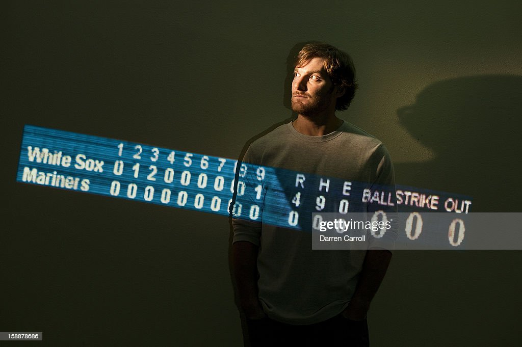 Portrait of Houston Astros pitcher Philip Humber posing in front of projection of scoreboard from his perfect game. He pitched it as a member of the Chicago White Sox. Darren Carroll F41 )