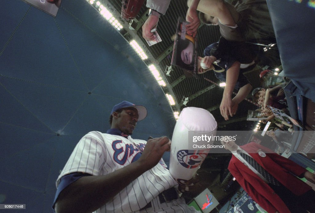 9e69001667a Montreal Expos Vladimir Guerrero signing autographs for fans before ...