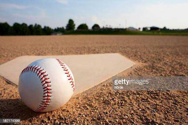 A baseball Near a diamond on a baseball field
