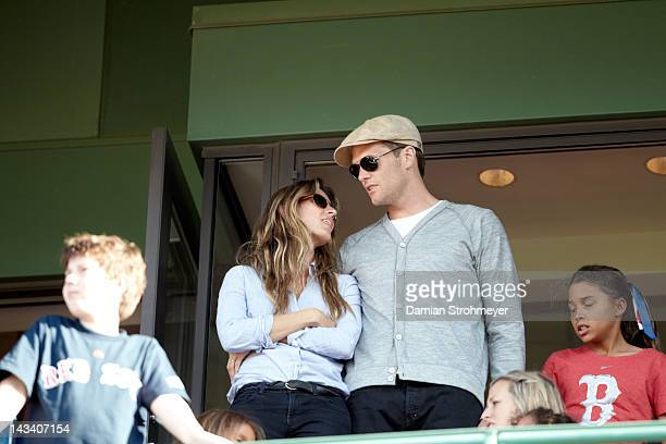 New England Patriots QB Tom Brady with wife Gisele in stands during Boston Red Sox vs New York Yankees game at Fenway Park Boston MA CREDIT Damian...