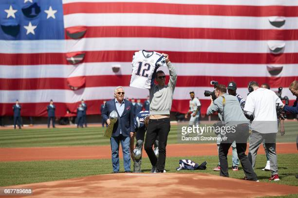 New England Patriots Tom Brady holding up his stolen Super Bowl jersey during ceremony before Boston Red Sox vs Pittsburgh Pirates game at Fenway...