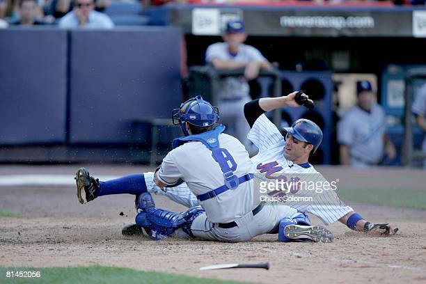 Baseball: New York Mets Doug Mientkiewicz in action, making home plate slide vs Los Angeles Dodgers Jason Phillips , Flushing, NY 7/23/2005