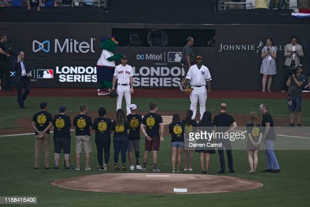 New York Yankees CC Sabathia and Boston Red Sox Chris Sale before ceremonial first pitch before game at London Stadium London Series London England...
