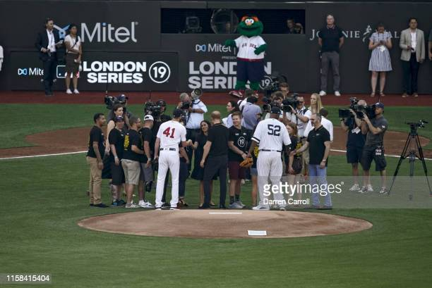 New York Yankees CC Sabathia and Boston Red Sox Chris Sale after ceremonial first pitch before game at London Stadium London Series Sale shaking...