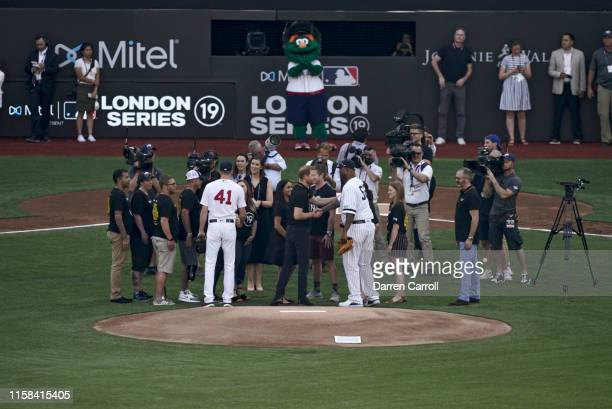 New York Yankees CC Sabathia and Boston Red Sox Chris Sale after ceremonial first pitch before game at London Stadium London Series Sabathia shaking...