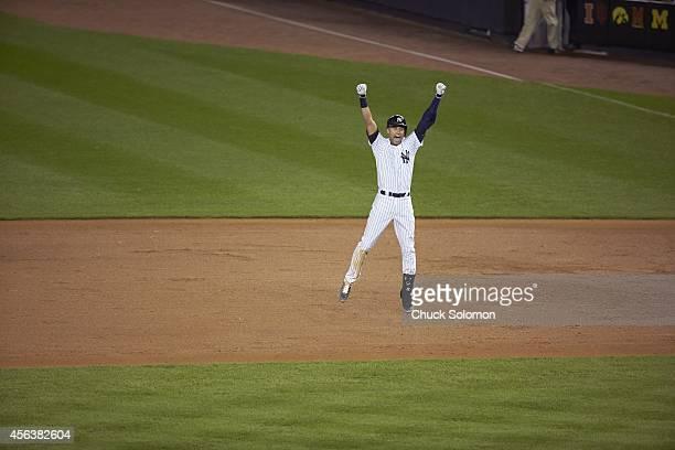 New York Yankees Derek Jeter victorious after game winning walk of single vs Baltimore Orioles at Yankee Stadium Jeter's final home game Bronx NY...