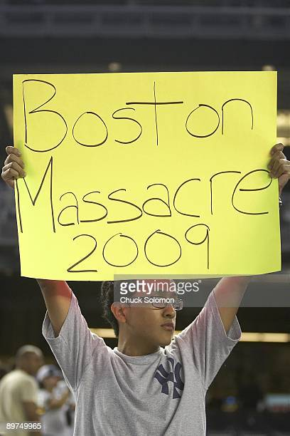 New York Yankees fan in stands with sign that reads BOSTON MASSACRE 2009 during game vs Boston Red Sox. Bronx, NY 8/9/2009 CREDIT: Chuck Solomon
