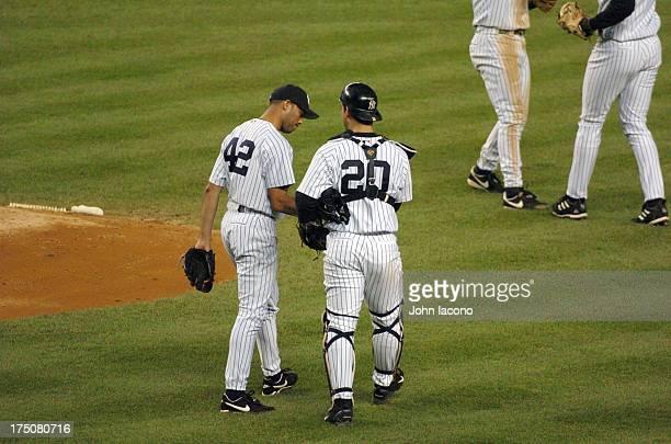 New York Yankees Mariano Rivera victorious on mound with Jorge Posada after winning game vs Minnesota Twins at Yankee Stadium Rivera saves both games...