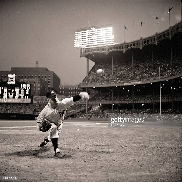 Baseball New York Yankees Whitey Ford in action warming up in bullpen during game vs Boston Red Sox Bronx NY 8/10/1955