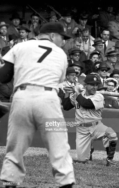 New York Yankees Yogi Berra on deck with Mickey Mantle in foreground during at bat vs Washington Senators at Griffith Stadium Washington DC CREDIT...