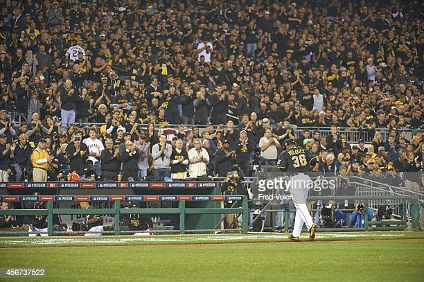 NL Wild Card Game Pittsburgh Pirates Edinson Volquez returning to dugout after getting pulled from game vs San Francisco Giants at PNC Park...