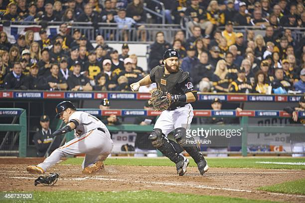 NL Wild Card Game Pittsburgh Pirates Russell Martin in action making force out at home plate of San Francisco Giants Joe Panik during 7th inning at...