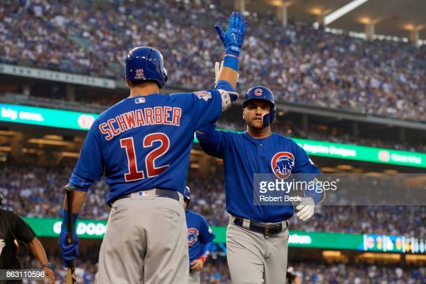 NLCS Playoffs Chicago Cubs Albert Almora Jr victorious with Kyle Schwarber during game vs Los Angeles Dodgers at Dodger Stadium Game 1 Los Angeles CA...