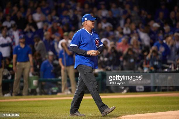 NLCS Playoffs Former Chicago Cubs player Ryne Sandberg preparing to throw out ceremonial first pitch before game vs Los Angeles Dodgers at Wrigley...