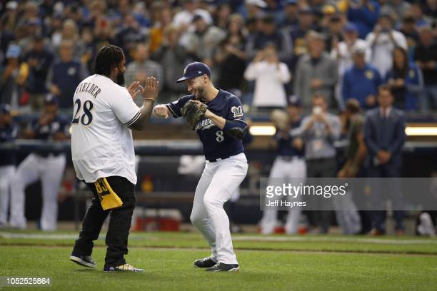 NLCS Playoffs Former Milwaukee Brewers Prince Fielder victorious with Ryan Braun after throwing first pitch vs Los Angeles Dodgers during Game 2 at...