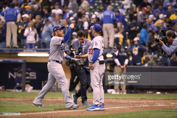 NLCS Playoffs Los Angeles Dodgers Justin Turner giving fist bump to manager Dave Roberts vs Milwaukee Brewers during Game 2 at Miller Park Milwaukee...