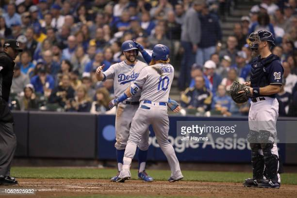 NLCS Playoffs Los Angeles Dodgers Justin Turner victorious giving high five to Chris Taylor after hitting home run vs Milwaukee Brewers during Game 2...