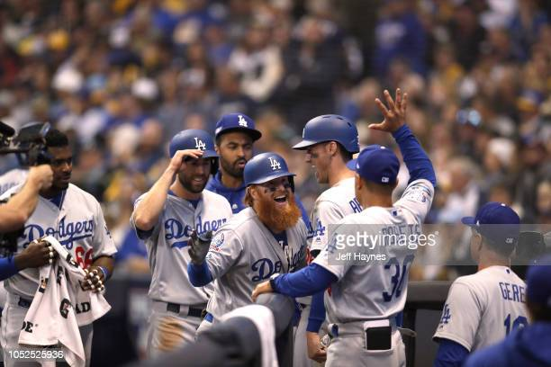 NLCS Playoffs Los Angeles Dodgers Justin Turner victorious giving high five to manager Dave Roberts after hitting home run vs Milwaukee Brewers...