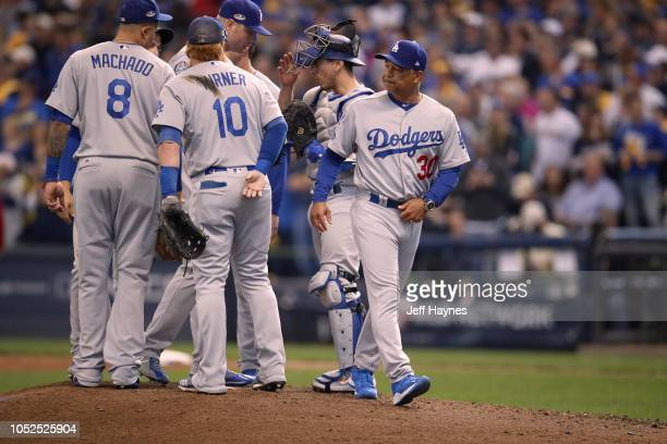 NLCS Playoffs Los Angeles Dodgers manager Dave Roberts leaving conference on the mound vs Milwaukee Brewers during Game 2 at Miller Park Milwaukee WI...