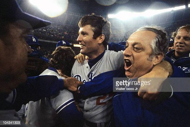 NLCS Playoffs Los Angeles Dodgers Tommy John victorious hugging mananger Tom Lasorda after winning Game 4 and series vs Philadelphia Phillies...