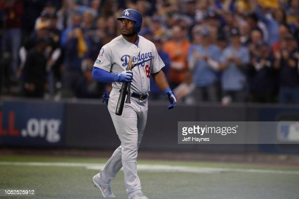 NLCS Playoffs Los Angeles Dodgers Yasiel Puig n action carrying broken bat to dug out after striking out vs Milwaukee Brewers during Game 2 at Miller...