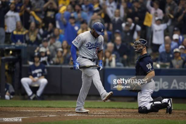 NLCS Playoffs Los Angeles Dodgers Yasiel Puig n action breaking bat after striking out vs Milwaukee Brewers during Game 2 at Miller Park Milwaukee WI...