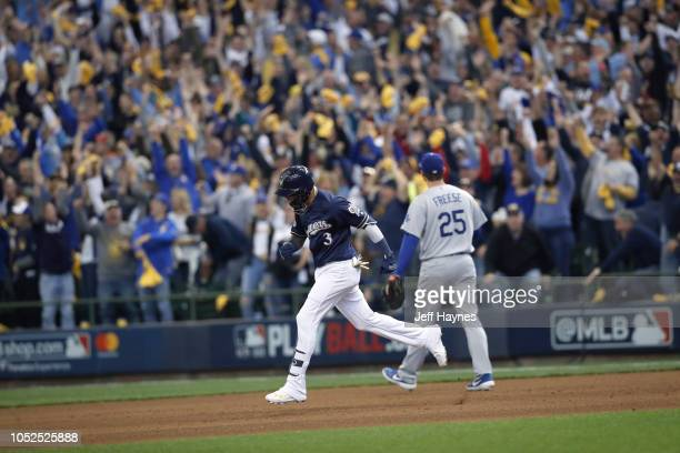 NLCS Playoffs Milwaukee Brewers Orlando Arcia victorious running bases after hitting home run vs Los Angeles Dodgers during Game 2 at Miller Park...