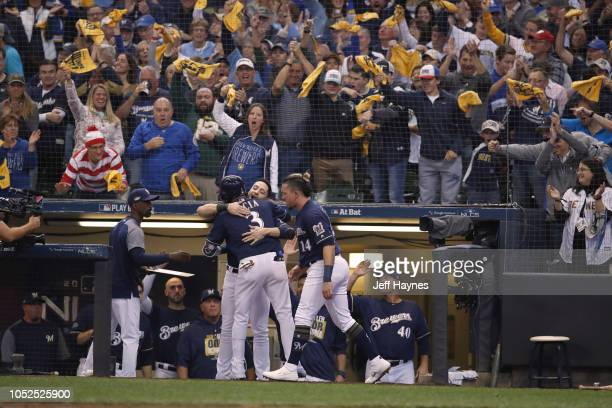 NLCS Playoffs Milwaukee Brewers Orlando Arcia victorious with teammates after hitting home run vs Los Angeles Dodgers during Game 2 at Miller Park...