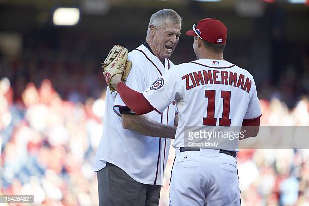NLDS Playoffs Former Washington Senators player Frank Howard shaking hands with Ryan Zimmerman after throwing out ceremonial first pitch before game...