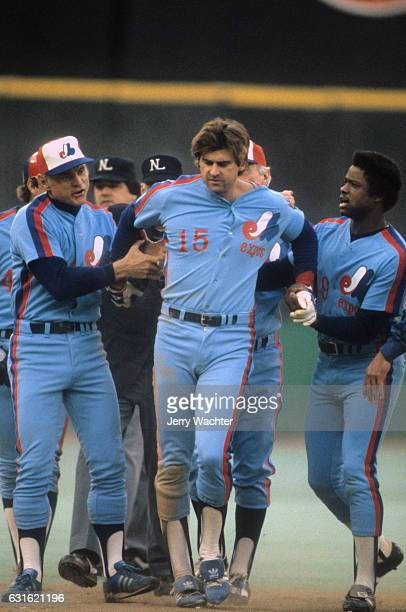 NLDS Playoffs Montreal Expos manager Jim Fanning Larry Parrish and Warren Cromartie during game vs Philadelphia Phillies at Veterans Stadium Game 5...
