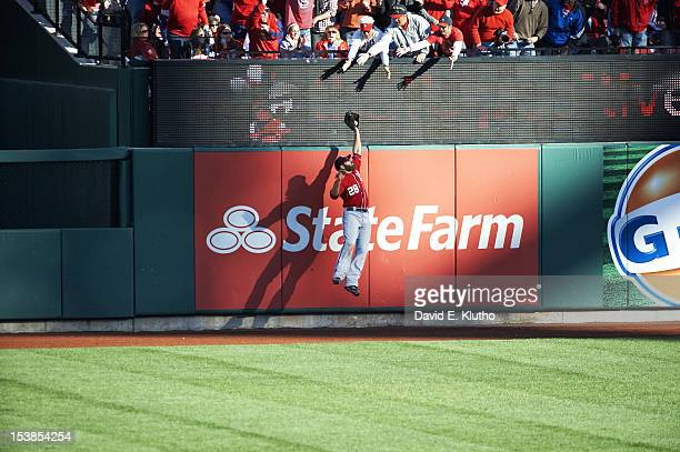 NLDS Playoffs Washington Nationals Jayson Werth in action making catch along outfield wall and taking HR away from St Louis Cardinals Daniel Descalso...