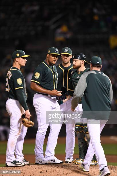 Oakland Athletics Jeurys Familia and Jonathan Lucroy on mound during mound visit and pitching change in game vs Seattle Mariners at Oakland Alameda...
