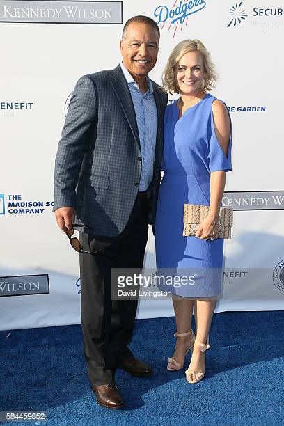 Baseball outfielder Dave Roberts and guest arrive at the Los Angeles Dodgers Foundation Blue Diamond Gala at the Dodger Stadium on July 28 2016 in...