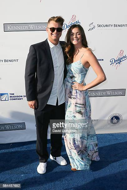 Baseball outfielder Joc Pederson and guest arrive at the Los Angeles Dodgers Foundation Blue Diamond Gala at the Dodger Stadium on July 28 2016 in...