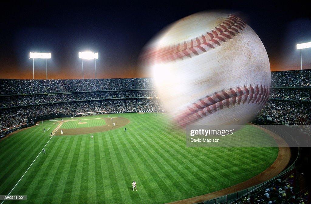 Baseball over stadium, blurred motion (Digital Composite) : Stock Photo