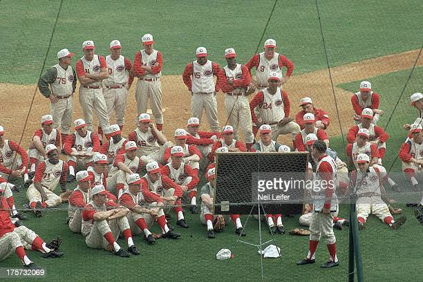 Overall view of Cincinnati Reds manager Dave Bristol talking to players on field during spring training at Al Lopez Field Tampa FL CREDIT Neil Leifer