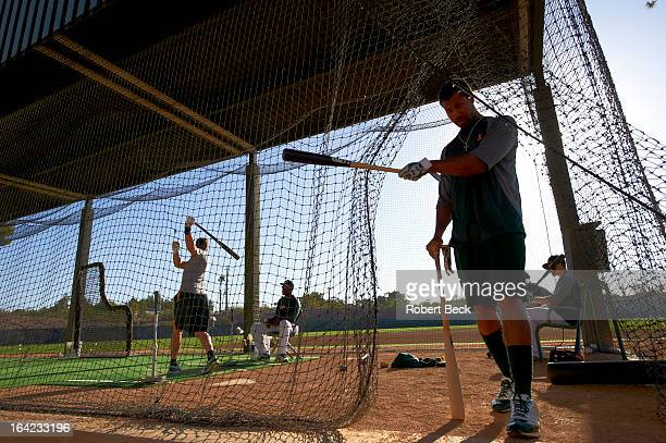 Overall view of miscellaneous action in batting cages during spring training photo shoot at Phoenix Municipal Stadium Phoenix AZ CREDIT Robert Beck