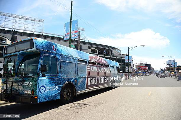 Overall view of Pace Suburban Bus Service bus with main marquee wraparound ad outside of Wrigley Field before Chicago Cubs vs Cincinnati Reds game on...