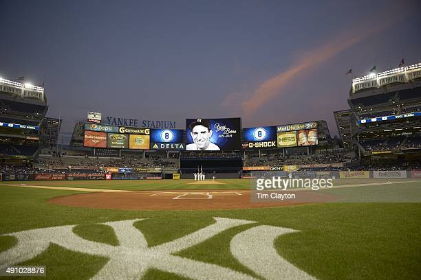 Overall view of picture of former New York Yankees catcher Yogi Berra on scoreboard honoring him after his passing before New York Yankees vs Chicago...