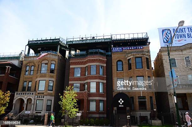 Overall view of Wrigley Rooftops and houses outside of Wrigley Field before Chicago Cubs vs Cincinnati Reds game on Sheffield Avenue Official Rooftop...