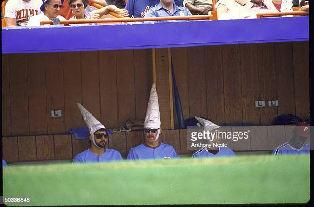 Phila Phillies Steve Bedrosian Kevin Gross wearing coneheads for NY Mets David Cone in dugout during game vs NY Mets Goofy
