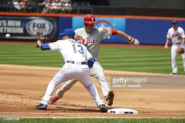 Philadelphia Phillies Chase Utley in action returning to first base vs New York Mets Josh Satin at Citi Field Flushing NY CREDIT Carlos M Saavedra