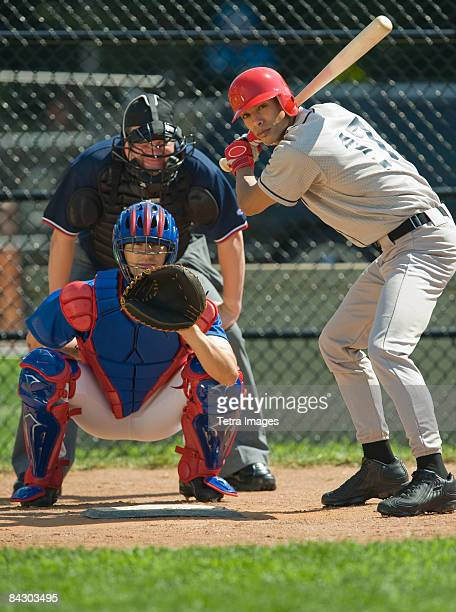 baseball pitcher, batter and umpire in ready position - baseball catcher stock photos and pictures